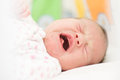 Crying newborn baby girl portrait of Stock Photography