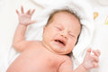 Crying newborn baby girl Royalty Free Stock Photo