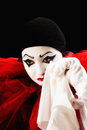 Crying pierrot mime actor dressed as with a hanky Royalty Free Stock Photos