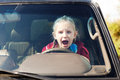 Crying scared girl in the car driving Royalty Free Stock Photo