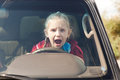 Crying scared girl in the car driving Stock Photography