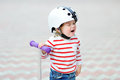Crying toddler boy in safety helmet with scooter Royalty Free Stock Photo