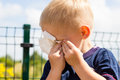 Crying unhappy little boy wiping his eyes Royalty Free Stock Photo