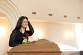 Crying woman with red rose and coffin at funeral Royalty Free Stock Photo