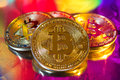 Cryptocurrency physical golden bitcoin coin on colorful backgrou
