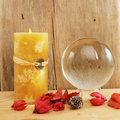 Crystal ball and candle Stock Image
