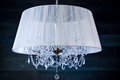 A crystal chandelier with a white shade Royalty Free Stock Photo