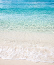 Crystal clear blue sea in bright sunlight and white wave at phuket beach, thailand Royalty Free Stock Photo