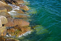 Crystal clear waters and rocks the blue green pink granite on the coast of maine Stock Photography