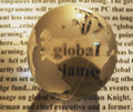 Crystal globe on newspaper Stock Photo