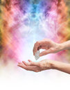 Crystal healer sensing energy with terminated quartz Royalty Free Stock Photo