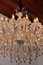 Crystal light a chandelier hanging from a ceiling Royalty Free Stock Photo