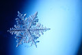 Crystal Snowflake On Blue Background