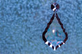 Crystal Teardrop Pendant, Hanging Against Blue Background Royalty Free Stock Photo
