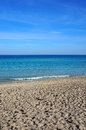 The crystalline water of sicily at mondello beach in in a sunny day Royalty Free Stock Photography