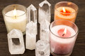 Crystals and color candles quartz aligned lighted Stock Image