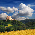 Csesznek Castle with blue cloudy sky in Hungary Royalty Free Stock Photo