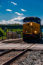 A csx train approaching a road crossing in brunswick md maryland Royalty Free Stock Photography