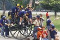Cub Scouts Playing on Cannon Royalty Free Stock Photography