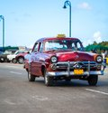 Cuba american oldtimer taxi on the main road in havana oldtimmer Royalty Free Stock Photo