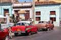 Cuba cars matanzas february people walk past old on february in matanzas new change in law allows cubans to trade Royalty Free Stock Images