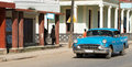 Cuba inland american blue oldtimer drives on the road midland Stock Photography