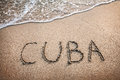 Cuba title on the sand beach near ocean Stock Images