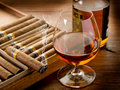 Cuban cigar and bottle of cognac Royalty Free Stock Photo