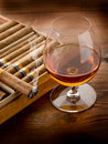 Cuban cigar and cognac on wood Stock Image