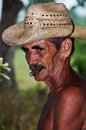 Cuban farmer with hat smokes cigar in Vinales, Cuba. Royalty Free Stock Images