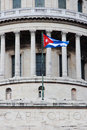 Cuban flag on Capitolio building in Havana. #1 Stock Photos