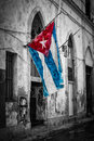 Cuban flag in a shabby street in Havana Royalty Free Stock Photo