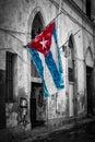 Cuban flag in a shabby street in Havana Royalty Free Stock Photo