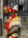 CUBAN LADY IN TRADITIONAL COLORFUL DRESS, HAVANA, CUBA Royalty Free Stock Photo