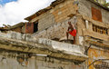Cuban man on decayed house, Havana Stock Photography