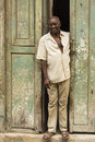 Cuban man standing in doorway Royalty Free Stock Photo