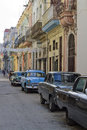Cuban street with old classic cars past international embargoes have meant cuba has maintained many pre revolutions vehicles Stock Image