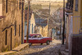 Cuban street with oldtimer in Trinidad Royalty Free Stock Photo