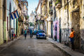 Cuban street view with people and cuban flag,  in La Havana, Cuba Royalty Free Stock Photo