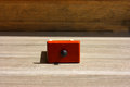 Cubby red on old wood Stock Photo