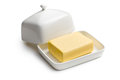 Cube of butter in ceramic jar Stock Photos