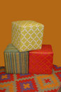 Cube shaped ottomen colorful modern ottomans for patio or living room Royalty Free Stock Images