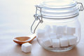 Cube sugar sugars and glass jar in the sunlight Stock Image