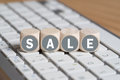 Cubes forming the word sale on a computer keyboard Royalty Free Stock Photo
