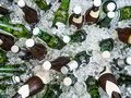 Cubes of ice and colorful bottles with cold beer Royalty Free Stock Photo