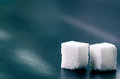 Cubes of sugar on a dark background. Unhealthy ingredients. Lump sugar Royalty Free Stock Photo