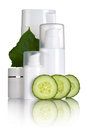 Cucumber cosmetics cosmetic bottles with slices and leaf on white background Stock Photo