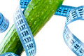 Cucumber with measuring tape. Royalty Free Stock Image