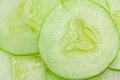 Cucumber sliced close up fresh green whole background Stock Photos