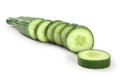 Cucumber sliced photo of a cut into thick slices over a white background Royalty Free Stock Images